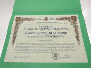 La pergamena con le motivazioni ufficiali della scelta di premiare il gruppo alpino bagnonese