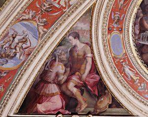 """""""Allegoria di Fivizzano"""", 1558. Firenze, Palazzo Vecchio, Sala di Cosimo I. Spicchio della volta incorniciato a stucco. L'allegoria della città è impersonata da una donna anziana inginocchiata davanti al duca Cosimo I che incorona """"per avergli rifatte le mura"""" e solleva da terra """"per averlo tutto restaurato"""". L'arme e una veduta reale della città, con la didascalia """"Fivizamun"""", identificano la città lunigianese."""
